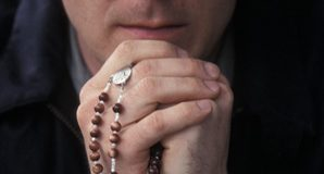 Priest Praying Rosary